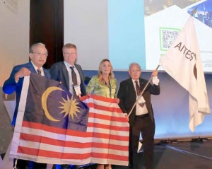 Handover of the ITA Flag to Malaysia as the host country for WTC 2020: Ir. Dr Teik Aun Ooi (Organising Chairman, right), Ir. David Kong Phooi Lai (IEM President, left) and Anna Ceppaluni (Honorary Consul of Malaysia in Italy) receiving the ITA flag from Andrea Pigorini (SIG President) in Naples, Italy, on Wednesday, 8 May 2019