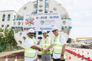 (From left to right) Mr. DV Raju, Senior Vice President-SOMA, Mr. Kapil Bhati, Managing Director-Robbins India, and Mr. Tamay Sayin, Project Manager-DSJV mark the occasion of the first Robbins TBM to be sent to India's Mumbai Metro Line 3 project. Photo: The Robbins Company