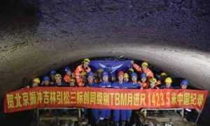 The crew celebrates the national-record-setting Robbins TBM for China's Jilin Lot 3 tunnel. The machine excavated in far more difficult ground at a higher rock strength than the current world record holder—also a Robbins TBM. (Source: The Robbins Company)