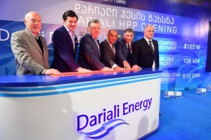 Lok Home, the Georgian Prime Minister, and project officials press the button to start up the Dariali hydropower station. Source: Robbins