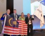 Handover of the ITA Flag to Malaysia as the host country for WTC 2020: Ir. Dr Ooi Teik Aun (Organising Chairman, right), Ir. David Kong Phooi Lai (IEM President, left) and Anna Ceppaluni (Honorary Consul of Malaysia in Italy) receiving the ITA flag from Andrea Pigorini (SIG President) in Naples, Italy, on Wednesday, 8 May 2019 (Photo: Roland Herr)